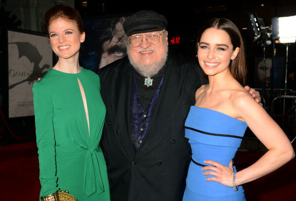 """george.jpg HOLLYWOOD, CA - MARCH 18:  Writer George R.R. Martin, center, actress Emilia Clarke, right, and actress Rose Leslie arrives to HBO's """"Game Of Thrones"""" Los Angeles Premiere at TCL Chinese Theatre on March 18, 2013 in Hollywood, California.  (Photo by Jeff Kravitz/FilmMagic)"""