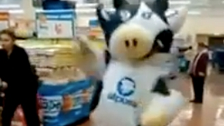 Watch These People Act Like There Isn't A Giant Cow Dancing In The Middle Of The Grocery Store