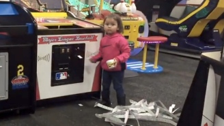 Watch This Badass Toddler Plunder A Chuck E. Cheese Ticket Machine For All It's Worth