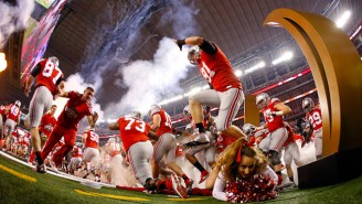 Watch This Ohio State Cheerleader Get Absolutely Demolished As Players Run Onto The Field