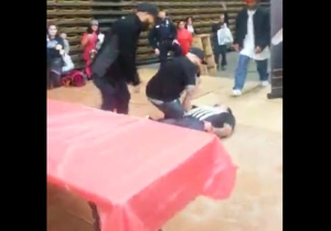 Watch This Guy Knock Someone Out With The Slap Heard 'Round The World