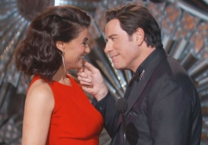 John Travolta Capped Off A Night Of Unwanted Groping By Not Letting Go Of Idina Menzel's Face