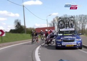 Watch This Service Car Take Out A Bicyclist During A Race
