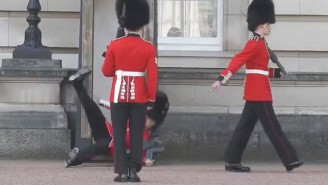 Here's The Buckingham Palace Guard Tripping, Falling, And Dropping His Rifle