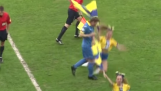 Watch This Cheerleader Execute A Flawless Slide Tackle On An Unsuspecting Player