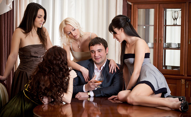 Man with many women