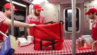 Improv Everywhere Gave Out Free Pizza To People Not 'Manspreading' On The Subway
