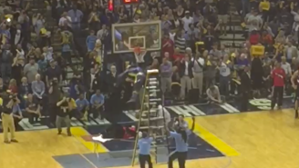 Watch The Memphis Grizzlies Mascot Jump Off A Ladder And Put The Blazers Mascot Through A Table