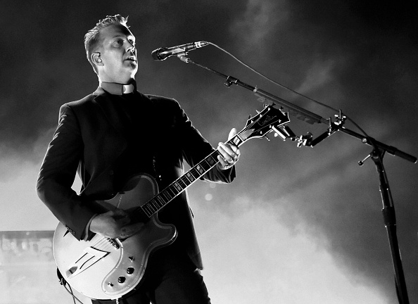 INGLEWOOD, CA - OCTOBER 31:  (EDITORS NOTE: This image was converted to black and white. Color version not available.) Musician Josh Homme of Queens of the Stone Age performs at the Forum on October 31, 2014 in Inglewood, California.  (Photo by Kevin Winter/Getty Images)