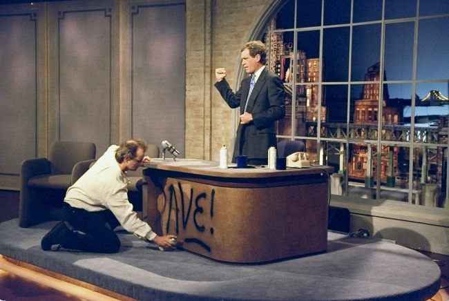 NEW YORK - AUGUST 30: Bill Murray spray paints Dave's desk on the first taping of the Late Show with David Letterman, August 30, 1993 on the CBS Television Network. This photo is provided by CBS from the Late Show with David Letterman photo archive. (Photo by Alan Singer/CBS via Getty Images)