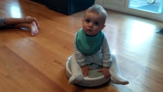 This Roomba-Riding Baby Will Turn Your Frown Upside Down