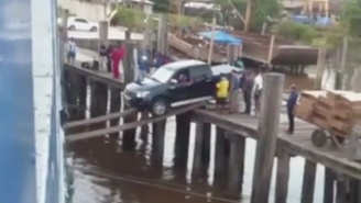 This Video Of A Car Attempting To Board A Ship Over Some Planks Will Have You On The Edge Of Your Seat
