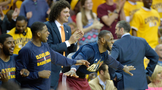 May 26, 2015; Cleveland, OH, USA; Cleveland Cavaliers forward LeBron James (23) reacts on the bench during the fourth quarter against the Atlanta Hawks in game four of the Eastern Conference Finals of the NBA Playoffs at Quicken Loans Arena. Mandatory Credit: David Richard-USA TODAY Sports
