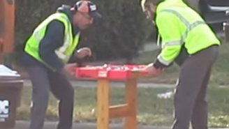 Watch Two Garbage Men Have A Heated Battle On Someone's Trashed Foosball Table