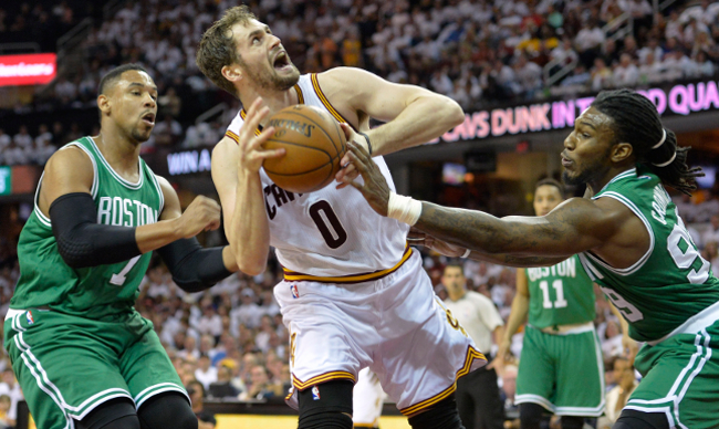 Apr 19, 2015; Cleveland, OH, USA; Boston Celtics forward Jared Sullinger (7) and forward Jae Crowder (99) defend a shot by Cleveland Cavaliers forward Kevin Love (0) in the second quarter in game one of the first round of the NBA Playoffs at Quicken Loans Arena. Mandatory Credit: David Richard-USA TODAY Sports