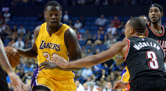 Oct 22, 2014; Ontario, CA, USA;  Portland Trail Blazers guard C.J. McCollum (3) defends Los Angeles Lakers forward Julius Randle (30) in the second half of the game at Citizens Business Bank Arena. Lakers won 94-86. Mandatory Credit: Jayne Kamin-Oncea-USA TODAY Sports