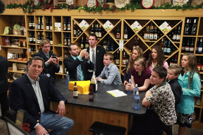 "The Duggars (Josh is second from right) having a drink with ""presidential candidate"" Rick Santorum"