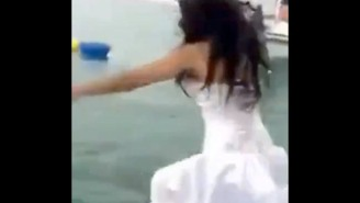 This Damn Fool Bride Almost Drowned Attempting To 'Trash The Dress'