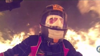 Watch Two Men Rip Through A 400-Foot Tunnel Of Fire On One Motorcycle