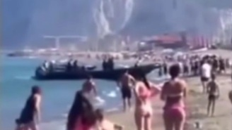 Here's A Boat Nonchalantly Unloading Drugs Onto A Crowded Beach In Spain