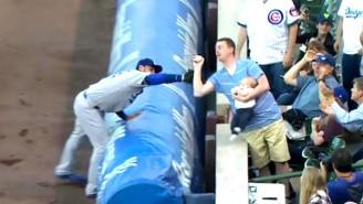 World's Greatest Dad Grabs A Foul Ball While Feeding A Baby