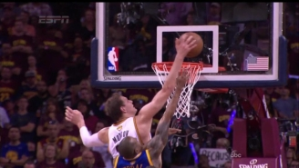 Timofey Mozgov Rises Up For The Huge Block On Andre Iguodala