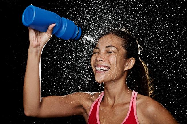 woman splashing herself with water derpy