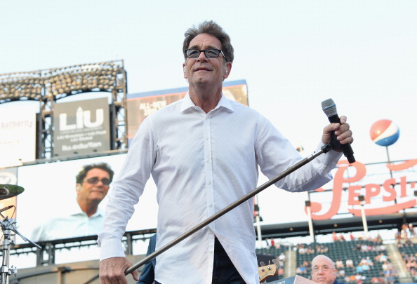 NEW YORK, NY - JULY 12:  Singer Huey Lewis of the band Huey Lewis & the News performs in concert at Citi Field on July 12, 2014 in New York City.  (Photo by Mike Coppola/Getty Images)