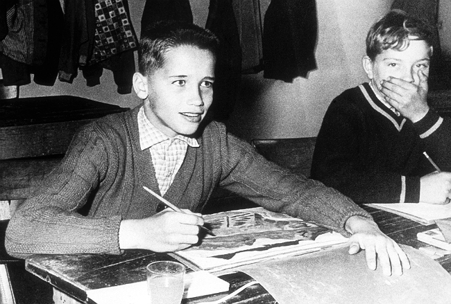 Eleven year old Schwarzenegger, left, poses for a photo in 1958 in Thal, Austria.