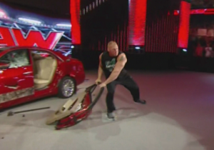 Watch Brock Lesnar Hurl A Car Door Into The Crowd On Raw And Hit A Fan