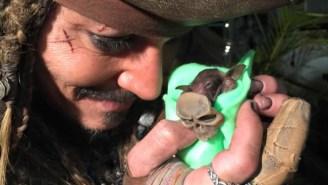 Here's Johnny Depp Bottle Feeding A Baby Bat As Jack Sparrow