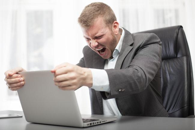 man angry at internet