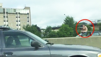 This Naked Guy Perched On His Car Roof Amidst Highway Traffic Because 'Everybody Hurts'