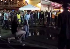 Watch This Guy Receive Comeuppance For Throwing Beer Bottles Into A Crowd