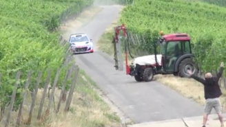 Watch This Rally Car Almost Get Destroyed By A Tractor