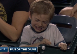 Watch This Young Baseball Fan Desperately Try (And Fail) To Crack Open A Pesky Peanut