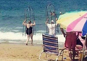 Are These Brilliant Beachgoers Really Using A Homemade Shark Cage?