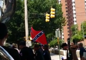 Watch As This Sousaphone Player Trolls A Group Of Confederate Flag Supporters On Their Way To A KKK Rally