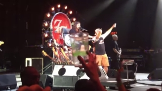 Dave Grohl Makes A Fan's 50th Birthday By Chugging A Beer With Him On Stage