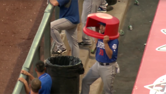 Watch As This Baseball Player Successfully Uses A Trash Can Lid As A Helmet