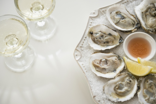 Studio shot of white wine and oysters