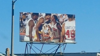 This New Billboard In L.A. Immortalizes A Kiss Between Magic Johnson And Isiah Thomas