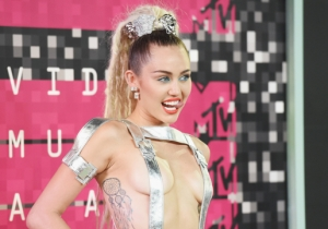Miley Cyrus Did Not Fail To Bring The Shock Factor With Her VMAs Red Carpet Look