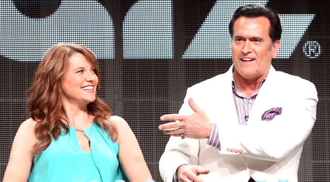BEVERLY HILLS, CA - JULY 31:  Actors Lucy Lawless (L) and Bruce Campbell speak onstage during the 'Ash vs. Evil Dead' panel discussion at the STARZ portion of the 2015 Summer TCA Tour at The Beverly Hilton Hotel on July 31, 2015 in Beverly Hills, California.  (Photo by Frederick M. Brown/Getty Images)