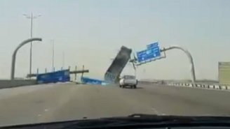Watch This Oblivious Dump Truck Driver Run Directly Into A Highway Sign