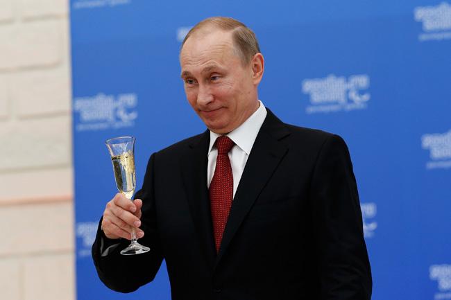 Russian President Vladimir Putin Meets With President Of The IPC Sir Philip Craven