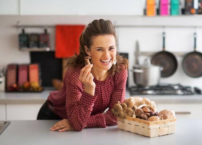 woman-with-mushroom_Shutterstock