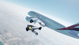 Enjoy This Amazing Clip Of Two Men With Jet Packs Flying Side-By-Side With An Airliner