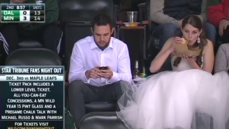 This Woman Went To A Hockey Game In Her Wedding Dress And Ate A Big Ol' Burger