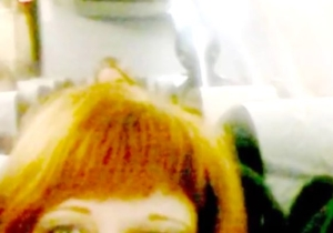 What's Going On In This Image Of A Woman Being Photobombed By An 'Alien'?